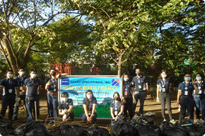 Participating in a tree-planting event
